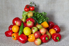 Vegetables and fruit lies a gray canvas Stock Photography