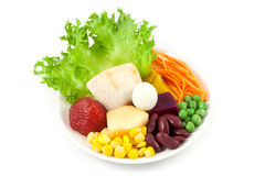 Vegetables and fruit salad Stock Photos