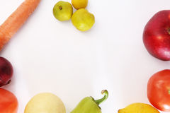 Vegetables and fruit on a white background. In a circle Stock Photography