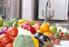 Vegetables and fruits. Fresh vegetables and fruits near the sink on the kitchen Stock Photos