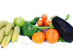 Vegetables and fruits. Fresh vegetables and fruits on white background stock photo