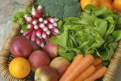 Vegetables and fruits. Fresh vegetables and fruits in a basket stock photo