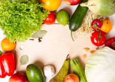 Vegetables and fruits around the cutting board Stock Images