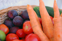 Vegetables and fruits in a basket Stock Images