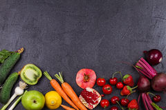 Vegetables and fruits on black background Stock Photo