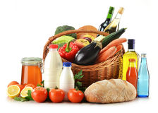 Vegetables, fruits, bread and wine in wicker baske Royalty Free Stock Image
