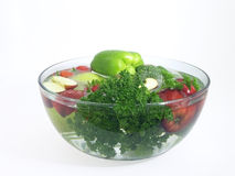 Vegetables and fruits in a clear bowl; 1 of 5. Vegetables and fruits in clear wash bowl Royalty Free Stock Photography
