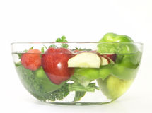 Vegetables and fruits in a clear bowl; 3 of 5. Vegetables and fruits in clear wash bowl Royalty Free Stock Photography