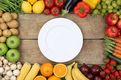 Vegetables and fruits with empty plate Royalty Free Stock Photos