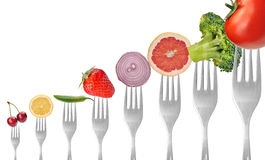 Vegetables and fruits on forks Royalty Free Stock Photos