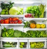 Vegetables and fruits in fridge. Fresh vegetables and fruits in fridge stock images