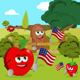 Vegetables and fruits holding the flag of the USA in a meadow Royalty Free Stock Photo