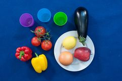 Vegetables and fruits are an important part of a healthy diet, and variety is as important. Vegetable food, red pepper, yellow bell pepper, cherry tomatoes Royalty Free Stock Images