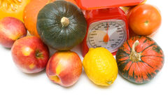Vegetables, fruits and kitchen scales close-up. white background Stock Photos