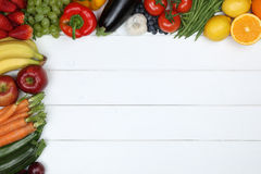 Vegetables and fruits like apple, orange, tomato with copyspace Stock Image