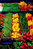 Vegetables and fruits on a market stall. Vegetables and fruits displayed on a market stall Stock Photography