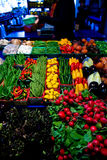 Vegetables and fruits on a market stall. Vegetables and fruits displayed on a market stall Royalty Free Stock Image