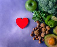 Vegetables, fruits and nuts with red wooden heart royalty free stock images
