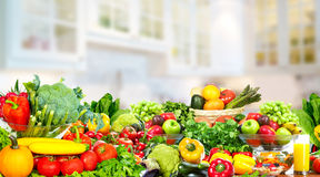 Vegetables and fruits over kitchen background. Stock Images