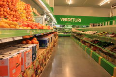 Vegetables. And fruits rayon in very neat and organized grocery store Royalty Free Stock Photos