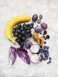 Vegetables and fruits rich in vitamin anthocyanin: bananas, blueberries, red cabbage, sweet purple onions, dark grapes. Prunes. Benefits of nutrition for the stock images