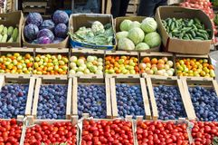 Vegetables and fruits for sale in cardboard boxes under the open sky. stock photos