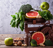 Vegetables, fruits, seeds  and nuts. Healthy vegetarian food. Vegetables, fruit, seeds and nuts. Selective focus Stock Photography