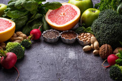 Vegetables, fruits, seeds  and nuts. Healthy vegetarian food. Vegetables, fruit, seeds and nuts. Selective focus Royalty Free Stock Photography