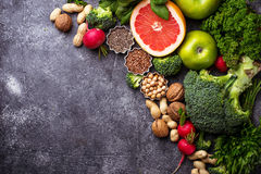 Vegetables, fruits, seeds  and nuts. Healthy vegetarian food. Vegetables, fruit, seeds and nuts. Selective focus Royalty Free Stock Photo
