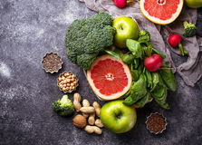 Vegetables, fruits, seeds  and nuts. Healthy vegetarian food. Vegetables, fruit, seeds and nuts. Selective focus Royalty Free Stock Image
