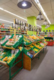 Vegetables and fruits on shelfes in supermarket Stock Photo