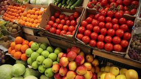 Vegetables and fruits on the shelves of the market. Farm fruit market. Showcase fruits and vegetables stock video footage