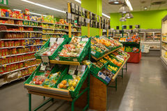 Vegetables and fruits on shop counters. CHAMONIX, FRANCE - JUNE 26, 2014: Vegetables and fruits on shop counters in supermarket royalty free stock photography