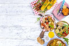 Vegetables, fruits and shrimp on the grill, for a summer lunch. Healthy food. Appetizers on a white background. Copy space. flat. Lay royalty free stock image