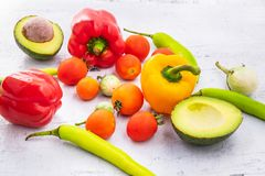 Vegetables and fruits On a white wooden background. stock photo
