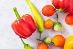 Vegetables and fruits On a white wooden background. royalty free stock photography