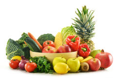 Vegetables and fruits in wicker basket isolated Stock Image