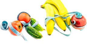Vegetables and  fruits wrapped in measuring tape Stock Images