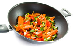 Vegetables in frying pan stock images