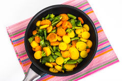 Vegetables in frying pan, top view. Studio Photo Royalty Free Stock Photo
