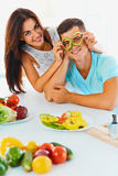 Vegetables are fun. Woman is holding slices of pepper before th Stock Images