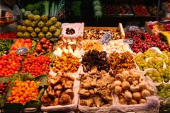 Vegetables and Fungi. Stand of fresh colourful fruits, vegetables, and mushrooms in La Boqueria market in Barcelona, Spain royalty free stock photography