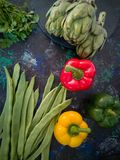 Vegetables from the garden on black background. With blue and green tones royalty free stock image