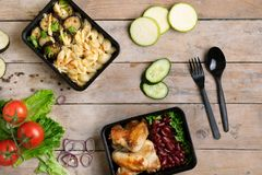 Vegetables from garden and food containers. Business lunch boxes royalty free stock photography