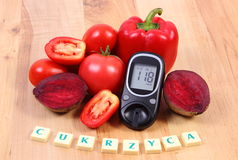 Vegetables, glucometer and polish word diabetes on wooden surface, healthy lifestyle and nutrition Stock Images