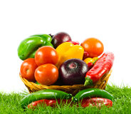 Vegetables on green gras on  white background healthy food Stock Photo