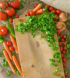 Vegetables - green salad, tomatoes, onion, carrots and pepperoni Stock Images