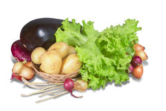 Vegetables and greenery with basket Royalty Free Stock Images