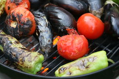 Vegetables on the grill. Tomatoes, eggplants, peppers on the grill Royalty Free Stock Images