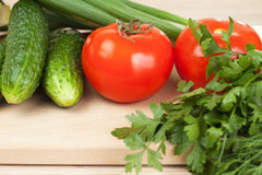 Vegetables on the hardboard Royalty Free Stock Photos